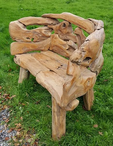 driftwood bench on grass