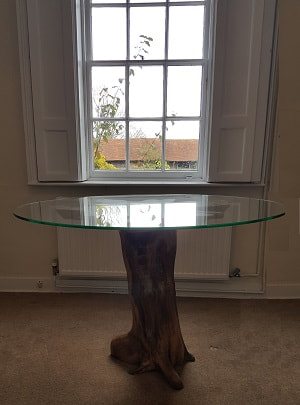 driftwood dining table with glass