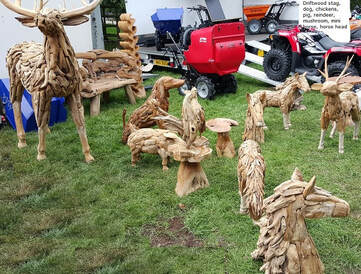 driftwood stag and other driftwood animals on show ground