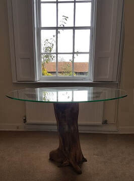 driftwood dining table by window