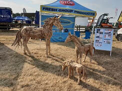 life-size driftwood horse and small driftwood horses