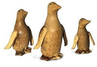 set of three wooden penguins