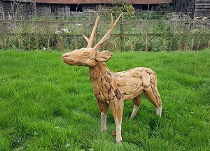 driftwood reindeer on grass